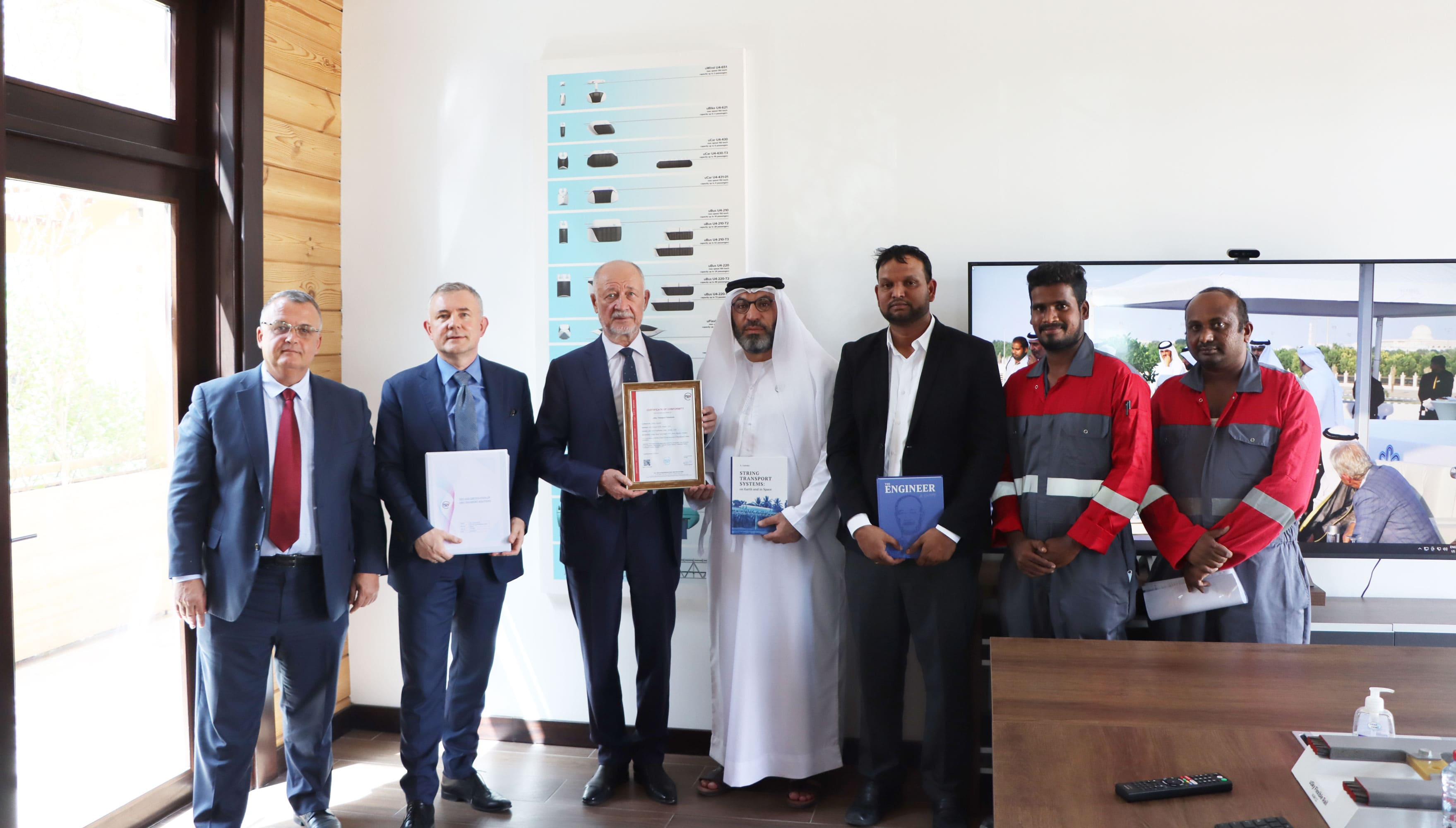 Handing over the safety certificate by TUV SW Standardization Certifications at uHouse (uSky Transport office), Sharjah, UAE